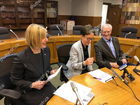 Stock Photo of Oregon House Democratic Leader Jennifer Williamson, left, House Speaker Tina Kotek, center, and House Republican Leader Carl Wilson share a laugh on as they speak with reporters during the Associated Press Legislative Preview at the State Capitol in Salem, Ore