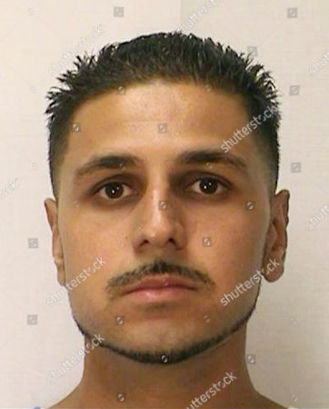 This Aug. 12, 2014 photo from the California Department of Corrections and Rehabilitation shows inmate Adnan Khan. A Northern California judge, citing a new state law, overturned Khan's murder conviction and ordered him released from custody. The San Francisco Chronicle reported, that Khan is believed to be the first California inmate to benefit from a new law limiting murder convictions exclusively to actual killers
