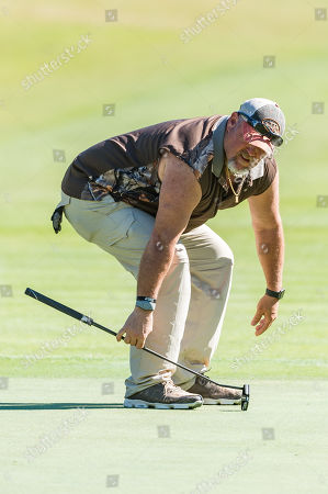 Lake Buena Vista, FL, United States of America: Actor comedian Larry the Cable Guy reacts to a putt during second round Diamond Resorts Tournament Of Champions held at Tranquilo Golf Course at Four Seasons Golf and Sports Club Orlando in Lake Buena Vista, Fla