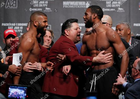 Officials pull apart Badou Jack, left, and Marcus Browne during a weigh-in, in Las Vegas. The two are scheduled to fight in a light heavyweight boxing bout Saturday