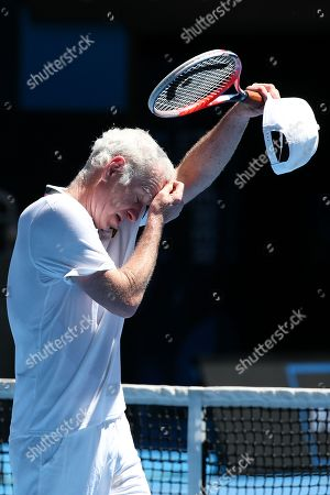 John Mcenroe reacts with Patrick Mcenroe (not pictured) of the USA while in action against Jonas Bjorkman and Thomas Johansson of Sweden during their second round men's legends doubles match at the Australian Open Grand Slam tennis tournament in Melbourne, Australia, 19 January 2019.