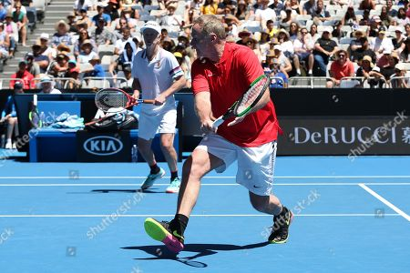 John Mcenroe (L) and Patrick Mcenroe (R) of the USA in action against Jonas Bjorkman and Thomas Johansson of Sweden during their second round men's legends doubles match at the Australian Open Grand Slam tennis tournament in Melbourne, Australia, 19 January 2019.