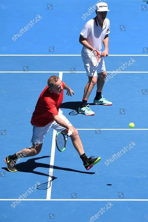 John Mcenroe (R) and Patrick Mcenroe (L) of the USA in action against Jonas Bjorkman and Thomas Johansson of Sweden during their second round men's legends doubles match at the Australian Open Grand Slam tennis tournament in Melbourne, Australia, 19 January 2019.
