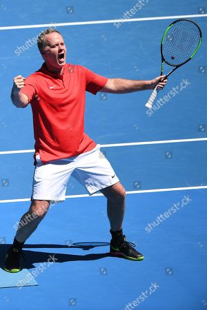 Patrick Mcenroe reacts while in action with John Mcenroe (not pictured) of the USA against Jonas Bjorkman and Thomas Johansson of Sweden during their second round men's legends doubles match at the Australian Open Grand Slam tennis tournament in Melbourne, Australia, 19 January 2019.