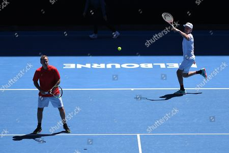 Stock Photo of John Mcenroe (R) and Patrick Mcenroe (L) of the USA in action against Jonas Bjorkman and Thomas Johansson of Sweden during their second round men's legends doubles match at the Australian Open Grand Slam tennis tournament in Melbourne, Australia, 19 January 2019.