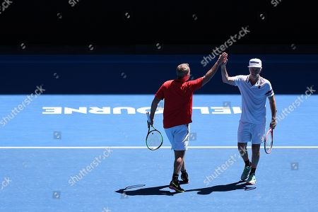 John Mcenroe (R) and Patrick Mcenroe (L) of the USA react while in action against Jonas Bjorkman and Thomas Johansson of Sweden during their second round men's legends doubles match at the Australian Open Grand Slam tennis tournament in Melbourne, Australia, 19 January 2019.