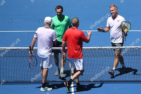 Stock Image of (L-R) John Mcenroe of the USA, Jonas Bjorkman of Sweden, Patrick Mcenroe of the USA, and Thomas Johansson of Sweden shake hands after their second round men's legends doubles match at the Australian Open Grand Slam tennis tournament in Melbourne, Australia, 19 January 2019.