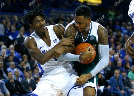 Buffalo forward Jeenathan Williams (11) and Eastern Michigan center Jason Thompson IV during the second half of an NCAA college basketball game, in Buffalo N.Y