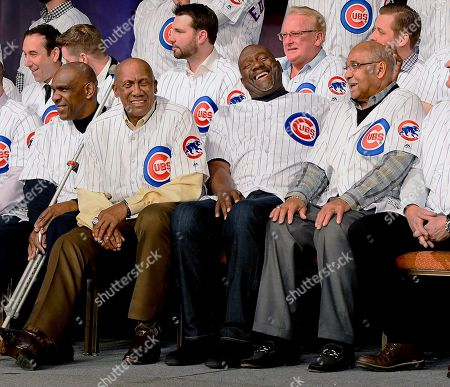 Stock Photo of Chicago Cubs' players from left, Andre Dawson, Ferguson Jenkins, Lee Smith and Billy Williams laugh during the team's annual convention, in Chicago