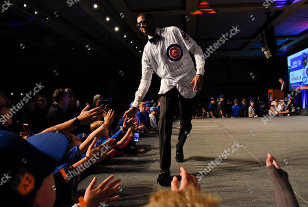 Chicago Cubs' Carl Edwards Jr. works the crowd during the team's annual convention, in Chicago