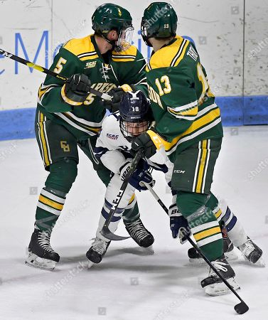 Stock Picture of Justin Pearson, Michael Underwood, Aaron Thow. Yale's Justin Pearson is squeezed between Clarkson's Michael Underwood and Aaron Thow during an NCAA hockey game on Friday, Jan.18, 2019 in New Haven, Conn