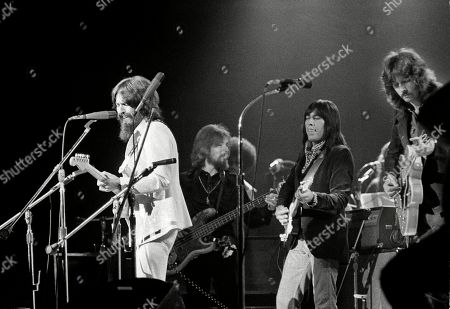 """George Harrison, Klaus Voorman, Jesse Ed Davis, Eric Clapton. Jesse Ed Davis, center right, a guitarist of Kiowa and Comanche ancestry, performs with George Harrison, left, formerly of the Beatles, at the Concert For Bangladesh at Madison Square Garden in New York City. Klaus Voorman is on bass, second from left, and Eric Clapton is at right. """"RUMBLE: The Indians Who Rocked the World,"""" a new PBS Independent Lens documentary set to air, shows how Native Americans laid the foundations to rock, blues and jazz"""