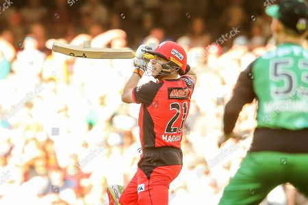 Marcus Harris of Melbourne Renegades plays an attacking stroke while Nic Maddinson of Melbourne Stars looks on during the Big Bash League match between Melbourne Renegades and Melbourne Stars at the Marvel Stadium, Melbourne. Picture by Martin Keep