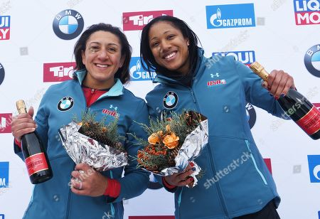 Third placed Elana Meyers Taylor (R) and Sylvia Hoffmann of the USA celebrates after the women's two-women Bobsleigh World Cup competition in Innsbruck, Austria, 19 January 2019.