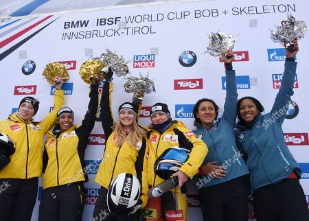 (L-R) Second places Kira Lipperheide and Mariama Jamanka of Germany, winner Ann-Christin Strack and Stephanie Schneider of Germany and third placed Elana Meyers Taylor and Sylvia Hoffmann of the USA celebrates on the Podium after the women's two-women Bobsleigh World Cup competition in Innsbruck, Austria, 19 January 2019.