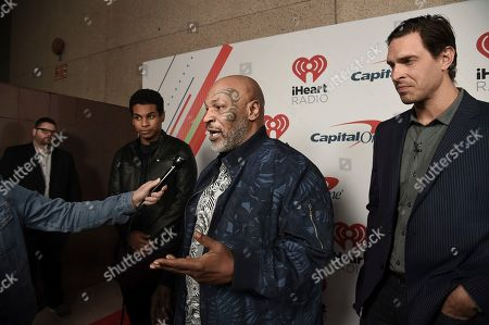 Miguel Leon Tyson, Mike Tyson, Eben Britton. Miguel Leon Tyson, from left, Mike Tyson and Eben Britton attend the 2019 iHeartRadio Podcast Awards at the iHeartRadio Theater on Friday, Jan.18, 2019, in Burbank, Calif
