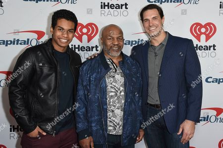 Stock Picture of Miguel Leon Tyson, Mike Tyson, Eben Britton. Miguel Leon Tyson, from left, Mike Tyson and Eben Britton attend the 2019 iHeartRadio Podcast Awards at the iHeartRadio Theater on Friday, Jan.18, 2019, in Burbank, Calif