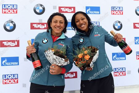 Elana Meyers Taylor, right and Sylvia Hoffmann from the United States celebrate their third place after the second run of the two-woman bobsled World Cup race in Igls, near Innsbruck, Austria