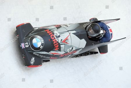 Britain's Brad Hall and Nick Gleeson compete during the first run of the two-man Bobsled World Cup race in Igls, near Innsbruck, Austria