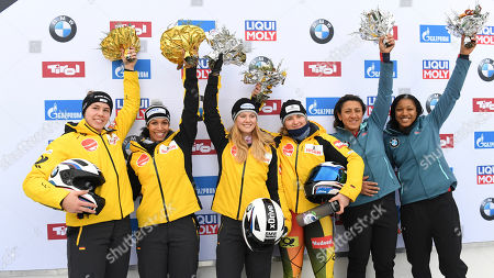 From left: Germany's second placed Mariam Jamanka, and Kira Lipperheide, Germany's winners Stephanie Schneider and Ann-Christin Strack, center, and United States third placed Elana Meyers Taylor and Sylvia Hoffmann pose for media after the two-woman bobsled World Cup race in Igls, near Innsbruck, Austria
