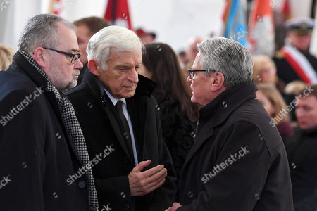 (L-R) Piotr Adamowicz, brother of late Pawel Adamowicz, former Polish Prime Minister Jerzy Buzek and former German President Joachim Gauck attend a funeral service of the late Gdansk Mayor Pawel Adamowicz at St. Mary's Basilica in Gdansk, Poland, 19 January 2019. On 13 January evening Gdansk Mayor Pawel Adamowicz was stabbed by a recently released convicted criminal who rushed onto the stage during the Great Orchestra of Christmas Charity finale in Gdansk. Adamowicz died from his injuries on 14 January afternoon without regaining consciousness. Adamowicz will be laid to rest in Gdansk's St. Mary's Basilica.