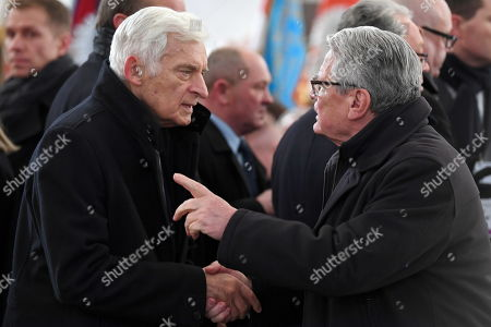 Stock Image of Former Polish Prime Minister Jerzy Buzek (L) and former German President Joachim Gauck (R) attend a funeral service of the late Gdansk Mayor Pawel Adamowicz at St. Mary's Basilica in Gdansk, Poland, 19 January 2019. On 13 January evening Gdansk Mayor Pawel Adamowicz was stabbed by a recently released convicted criminal who rushed onto the stage during the Great Orchestra of Christmas Charity finale in Gdansk. Adamowicz died from his injuries on 14 January afternoon without regaining consciousness. Adamowicz will be laid to rest in Gdansk's St. Mary's Basilica.