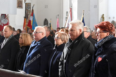 (L-R) President of the European Council Donald Tusk with his wife Malgorzata Tusk, Former Polish President and Nobel Peace Prize laureate Lech Walesa and his wife Danuta Walesa, former Polish President Aleksander Kwasniewski with his wife Jolanta Kwasniewska attend a funeral service of the late Gdansk Mayor Pawel Adamowicz at St. Mary's Basilica in Gdansk, Poland, 19 January 2019. On 13 January evening Gdansk Mayor Pawel Adamowicz was stabbed by a recently released convicted criminal who rushed onto the stage during the Great Orchestra of Christmas Charity finale in Gdansk. Adamowicz died from his injuries on 14 January afternoon without regaining consciousness. Adamowicz will be laid to rest in Gdansk's St. Mary's Basilica.