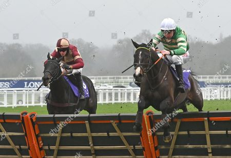 (R) Belargus (Leighton Aspell) takes the last before going on to win The Rosling King Juvenile Hurdle Race from (L) Zafar (Michael Nolan).
