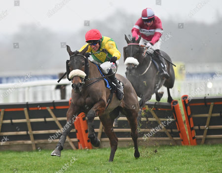 Stock Image of Magic Of Light (Robbie Power) takes the last before going on to win The OLBG.com Mares Hurdle Race from Petticoat Tails (Gavin Sheehan).