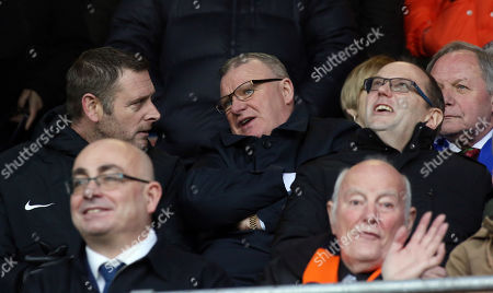 Stock Image of Peterborough United Manager Steve Evans watches from the Directors Box alongside Chairman Darragh MacAnthony