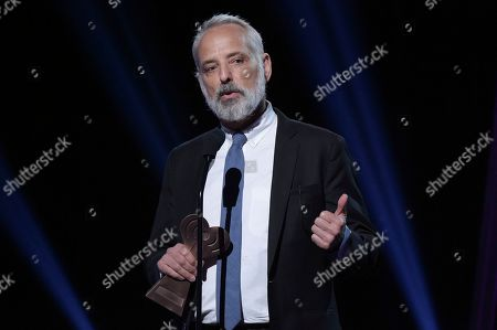 Marc Smerling accepts the Podcast Innovator Award during the 2019 iHeartRadio Podcast Awards at the iHeartRadio Theater on Friday, Jan.18, 2019, in Burbank, Calif