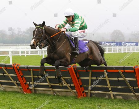 Belargus and Leighton Aspell jump the last to win the Rosling King Juvenile Novices' Hurdle at Ascot.