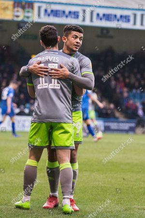 Stock Photo of Josh Gordon (Walsall) hugs Matt Jarvis (Walsall) following the goal from Andy Cook (Walsall) during the EFL Sky Bet League 1 match between Gillingham and Walsall at the MEMS Priestfield Stadium, Gillingham
