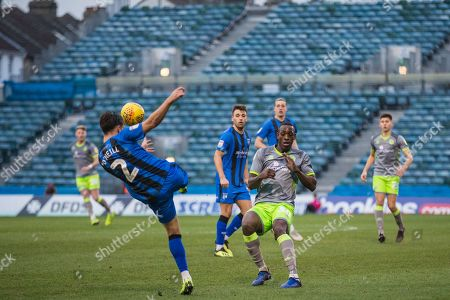 Isaiah Osbourne (Walsall) approaches Luke O'Neill (Gillingham) as he kicks the ball during the EFL Sky Bet League 1 match between Gillingham and Walsall at the MEMS Priestfield Stadium, Gillingham