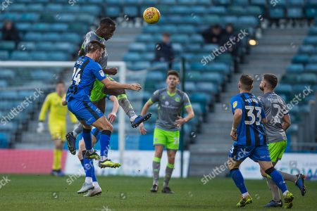 Isaiah Osbourne (Walsall) heads the ball during the EFL Sky Bet League 1 match between Gillingham and Walsall at the MEMS Priestfield Stadium, Gillingham
