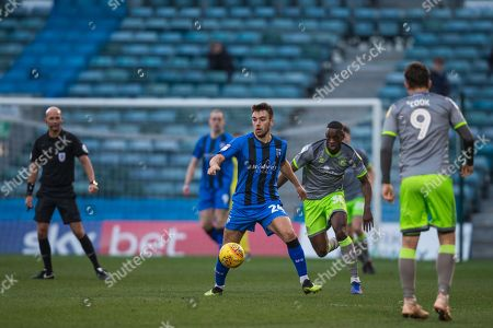 Josh Rees (Gillingham) in possession with Isaiah Osbourne (Walsall) moving in during the EFL Sky Bet League 1 match between Gillingham and Walsall at the MEMS Priestfield Stadium, Gillingham
