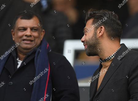 Queens Park Rangers Board Member Tony Fernandes looks down at Amit Bhatia