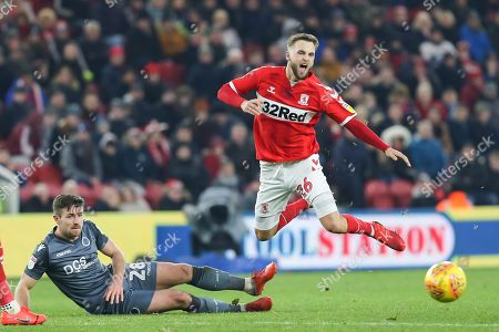 Stock Picture of Middlesbrough midfielder Lewis Wing (26) goes down on the edge of the box after a challenge from Millwall midfielder Ryan Leonard (28) during the EFL Sky Bet Championship match between Middlesbrough and Millwall at the Riverside Stadium, Middlesbrough