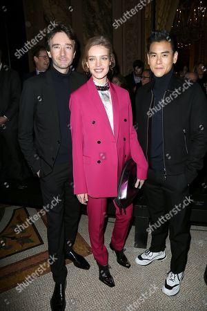 Antoine Arnault, Natalia Vodianova and Eddie Peng in the front row