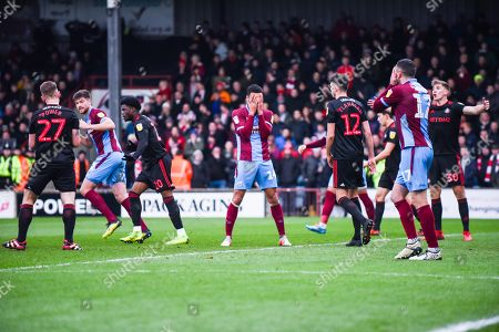 James Perch of Scunthorpe United (14) puts his hands over his face after missing a chance during the EFL Sky Bet League 1 match between Scunthorpe United and Sunderland at Glanford Park, Scunthorpe