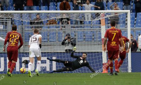 Stock Photo of Roma's Aleksander Kolarov, right, scores his side's second goal on a penalty past Torino goalkeeper Salvatore Sirigu, during a Serie A soccer match between Roma and Torino, at the Rome Olympic Stadium
