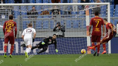 Roma's Aleksander Kolarov, right, scores his side's second goal on a penalty past Torino goalkeeper Salvatore Sirigu, during a Serie A soccer match between Roma and Torino, at the Rome Olympic Stadium