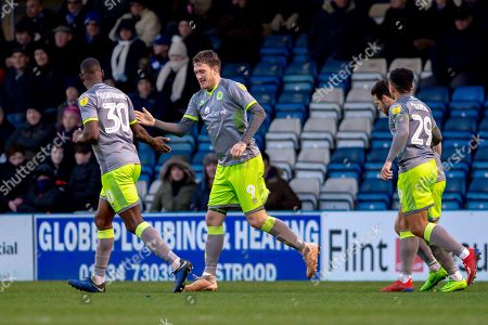 Walsall forward Andy Cook (9) scores a hat trick goal (0-3) and celebrates with team mate  Walsall  midfielder Isaiah Osbourne (30) during the EFL Sky Bet League 1 match between Gillingham and Walsall at the MEMS Priestfield Stadium, Gillingham