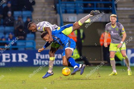 Walsall  midfielder Isaiah Osbourne (30) and Gillingham FC midfielder Regan Charles-Cook (11)  during the EFL Sky Bet League 1 match between Gillingham and Walsall at the MEMS Priestfield Stadium, Gillingham