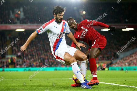Liverpool midfielder Naby Keita (8) nutmegs Crystal Palace defender James Tomkins (5) during the Premier League match between Liverpool and Crystal Palace at Anfield, Liverpool