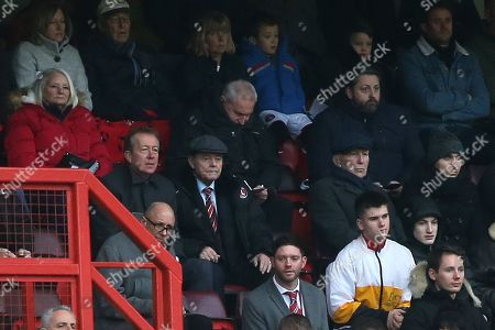 Former Charlton Manager, Alan Curbishley, (far left) sat in the Main Stand alongside former Charlton player, Keith Peacock (wearing a cap) during Charlton Athletic vs Accrington Stanley, Sky Bet EFL League 1 Football at The Valley on 19th January 2019