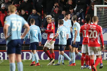 Lyle Taylor of Charlton has words with Accrington Stanley's Sam Finley as he walks towards the dressing room after receiving a red card during Charlton Athletic vs Accrington Stanley, Sky Bet EFL League 1 Football at The Valley on 19th January 2019