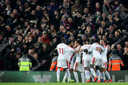 Crystal Palace fans celebrate their sides second goal scored by James Tomkins to make the score 2-2