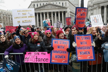 Participants take part in a Women's rally in lower Manhattan on in New York. A march through midtown Manhattan is being organized by the Women's March Alliance for the third year. But the downtown Manhattan rally at roughly the same time is being organized by a chapter of Women's March Inc., the group formed to help organize the 2017 demonstration in Washington. Women's March Inc. co-leader Tamika Mallory, who is black, has come under her fire from Jewish groups for her support of Nation of Islam leader Louis Farrakhan, who is known partly for his anti-Semitic rhetoric and condemnations of homosexuality