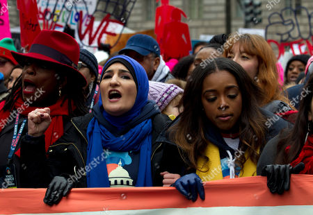 Stock Picture of Co-presidents of the 2019 Women's March Linda Sarsour, center, and Tamika Mallory, right, march along with others demonstrators on Pennsylvania Av. during the Women's March in Washington on . The Women's March returned to Washington on Saturday and found itself coping with an ideological split and an abbreviated route due to the government shutdown